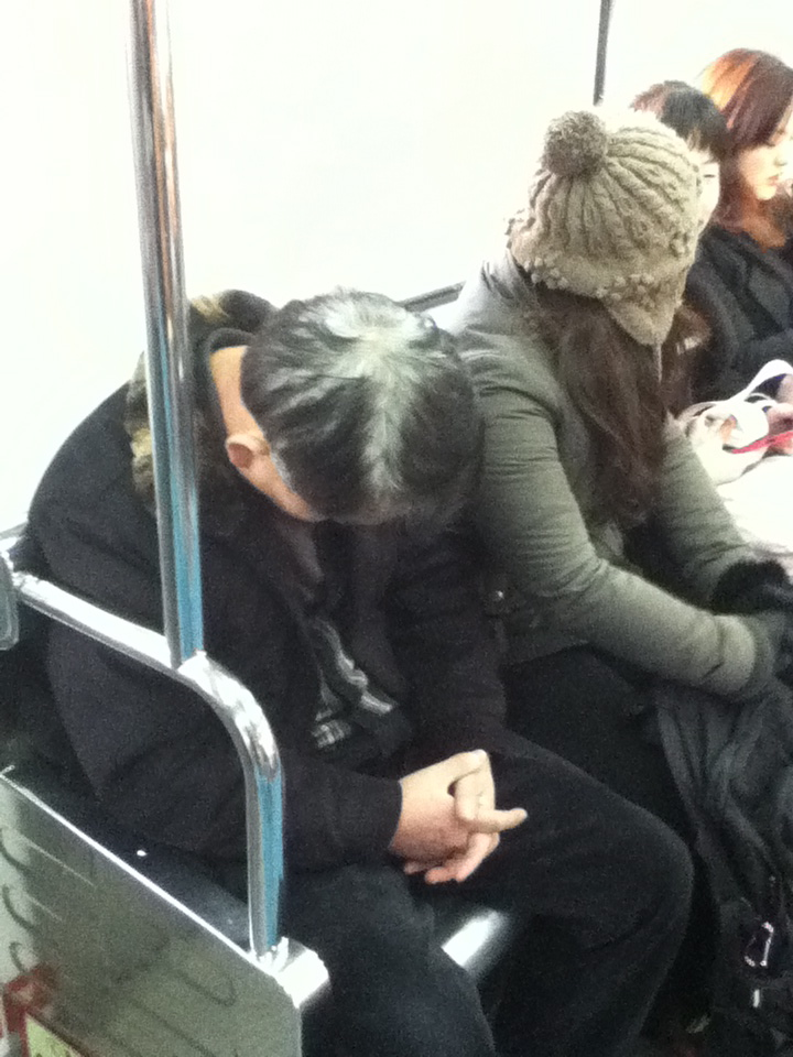 man sleeping on subway in Korea